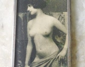 nude female photo on small purse hand mirror