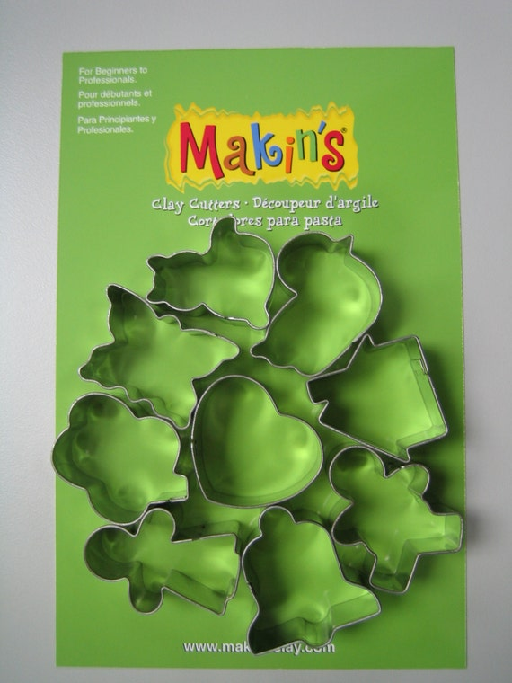 Makins 9 piece everyday - holidays  cookie or clay cutter includes a shamrock, cat, heart, duck, bell,butterfly, boy, girl and more