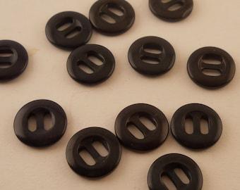 BUTTONS: 1 Dozen black buttons, 1/2 inch, 2 hole, small button.