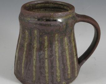 Wood ash glazed mottled olive green stoneware tankard