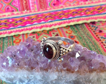 Garnet sterling silver swirl and bobble ring