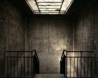 Chiaroscuro photography of stairs in an abandoned hospital in France