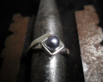 Sterling silver ring decorated with a Blue Pearl