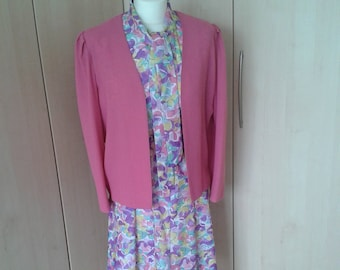 Ladies vintage dress suit from the 1980s with floral dress and matching cerise pink jacket