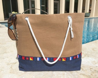 Navy and tan linen large beach bag resort tote with stunning nautical flag detailing, rope handles, key clip and anchor lining with pockets