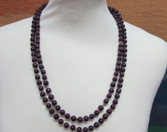 Vintage purple glass bead necklace, beads individually knotted