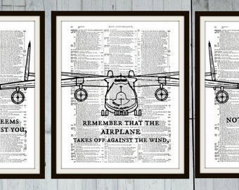Remember that the airplane takes off against the wind, not with it. - Henry Ford - Inspirational Quote Concordance 3 Book Pages Art Print