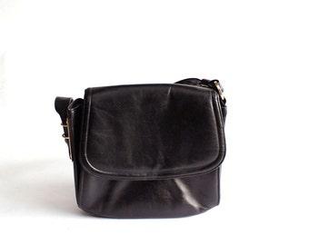 black vintage purse by Lewis with asymmetric hardware . 1960s purse
