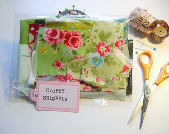 Green Cotton Fabric Scraps Bag. Fabric scrap bundle selection of designer fabrics, florals, hearts, cars, plain cottons. Ideal craft supply.