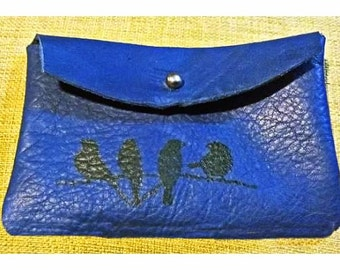 large blue leather pouch with birds on a wire print