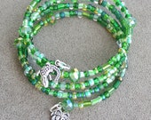 Green and Sparkly Cuff Bracelet with Czech Beads and Palm Tree and Alligator Charm