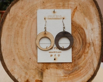 Circle. Wooden earrings are cut and laser engravings.