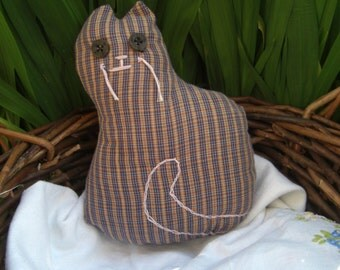 Soft toy cat in brown and blue stripes