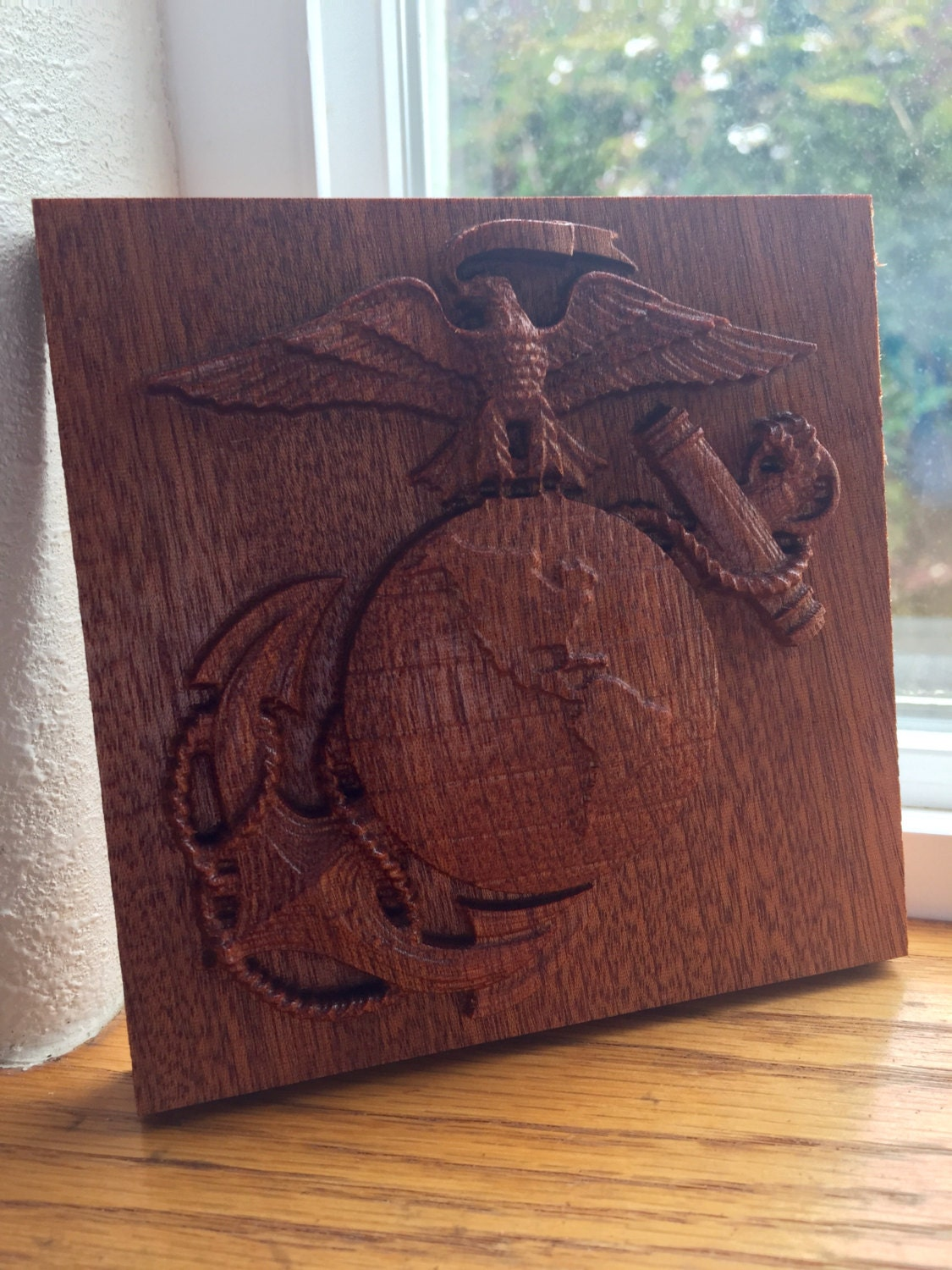 Us marine corps emblem carved in sapele wood