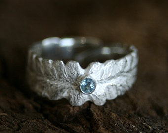 Wonderful silver ring in shape of a fern leaf with a waterblue topas