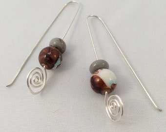 Silver spiral long drop earrings