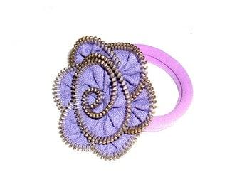 Handmade headband with purple zipper flower