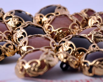 Gold metal Jewelry buttons with pearl effect in The centre