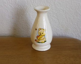 Tiny Glazed Vase with two different teddy bears on it.