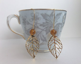 Golden Filigree Leaf Earrings With Glass Beads