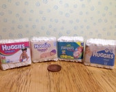 Pack of faux nappies for a dolls house 112 scale. 4 to choose from huggies or pampers.