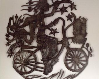 Haitian oilrum sculpture Angel on Bicycle