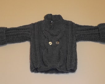 Hand knitted baby sweater with owl motif