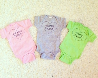 Miracles Happen on 100% Combed Ringspun Cotton Infant Onesie