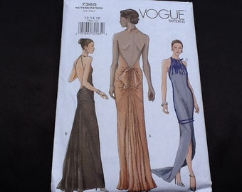 Vogue  pattern 7365. Uncut misses' close-fitting, lined, floor length, open back bias halter dress. Atonement dress. Sizes 6-10.