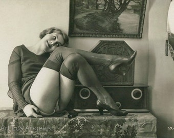 Photo of Woman with stockings, crossed legs, 1920s