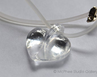 Clear Kiln Cast Crystal Glass Heart Pendant on clear rubber cord with silver clasp.