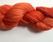 hand dyed sock yarn, fingering weight, merino and nylon, PERSIMMON colorway