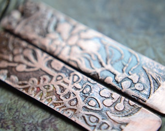 Etched copper earrings with foliage designs