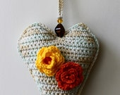 Crochet Hanging Heart Wall Hanging Decoration embellished with yellow and terracotta roebuds and beads.