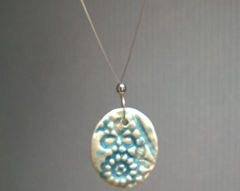 Necklace with porcelain pendant
