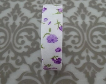 Adhesive tape with purple flowers