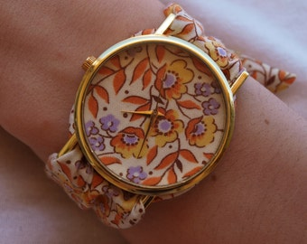 Watch lavender and orange floral print fabric