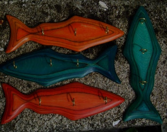Carved fish tea towel racks multi coloured