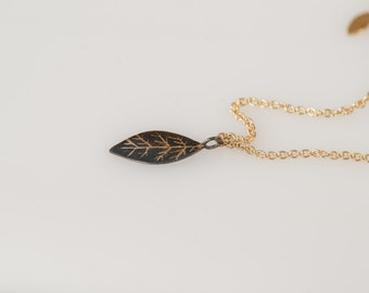 14K Yellow Gold necklace with 14K Yellow Gold and oxidized Sterling Silver (925) with 18K Gold Solder leaf pendants