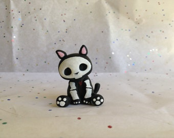 Polymer clay dead cat charm