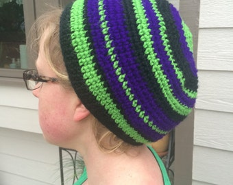 Green, black and purple beanie hat