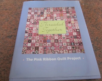 "Hardcover like new book ""Threaded Together: The Pink Ribbon Quilt Project"
