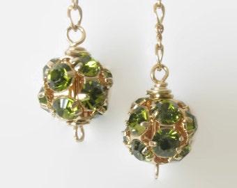 Peridot green Swarovski crystal earrings.  Disco ball dangle. Gold filled chain