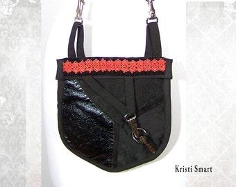 Granny is a goth black on black industrial pocket purse