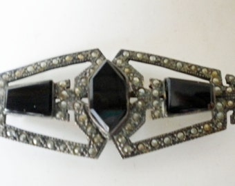 Vintage marcasite and black onyx brooch