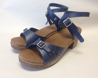 Bootcut Medium Heeled Navy sandal and wrap around ankle strap