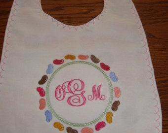 Monogrammed baby bib, ring of jelly beans, cotton, machine embroidery