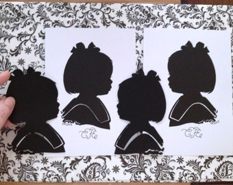 1 silhouette (left & right) + 2 extra (of one child) Silhouette portrait hand cut cameo children