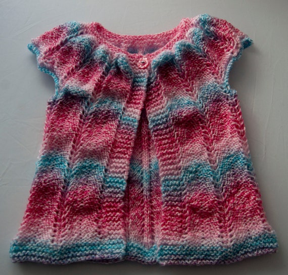 Handknitted Girls Sleeveless Cardigan for a 12 month child