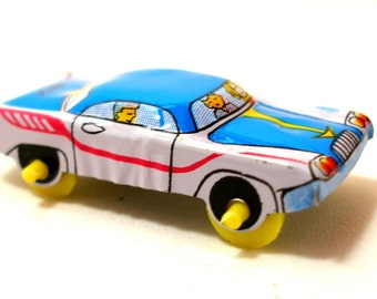 1960s Japanese tin toy car, blue & white with red stripe.
